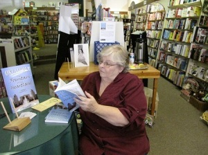 S.L. Winchester signing books for customers
